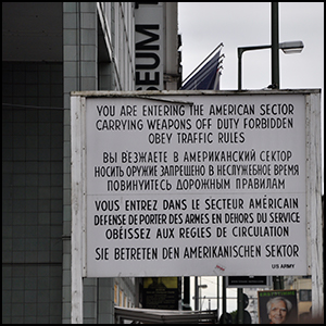 Checkpoint Charlie Berlin by Francisco Antunes [CC-BY-SA-2.0 (http://creativecommons.org/licenses/by-sa/2.0)], via Flickr https://flic.kr/p/j3Maw2 [cropped]