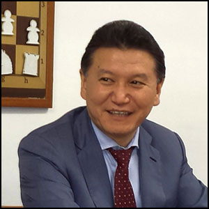 Visita Ilyumzhinov by Federació d'Escacs Valls d'Andorra [CC-BY-SA-2.0 (http://creativecommons.org/licenses/by-sa/2.0)], via https://commons.wikimedia.org/wiki/File:Kirsan_Ilyumzhinov_2014.jpg[cropped]