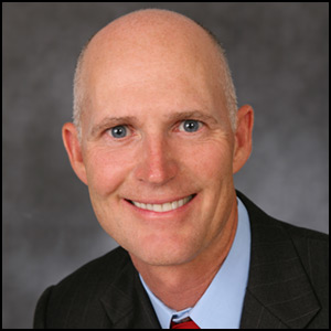 Rick Scott Head Shot by Rick Scott [CC-BY-SA-2.0 (http://creativecommons.org/licenses/by-sa/2.0)], via Flickr https://flic.kr/p/7Td7dc 2007 [cropped]