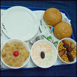 Tasty Meal on Sudan Air via http://www.sudanair.com/uploads/photos/97226DSC00043.JPG [Fair Use]